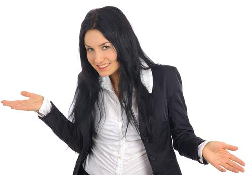 A lady with a smile wearing a white business shirt
