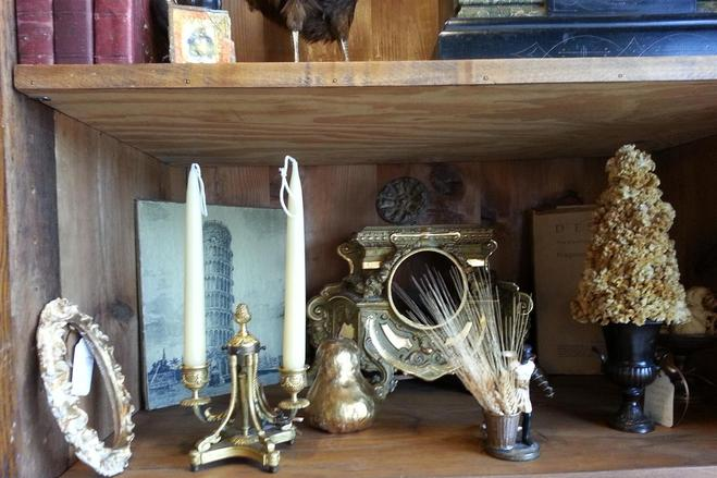 decor accessories and accents from the House of Tuscany antique mirror frame, brass candle sticks holders, gold leaf pear items bronze urn