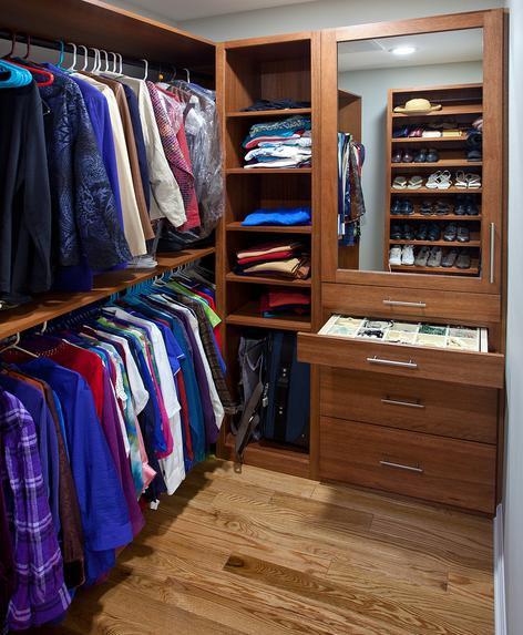 Multi level closet with shelving and jewelry storage in master closet