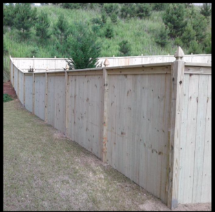 Privacy wood fence with gothic wood posts