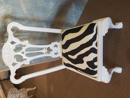 this is a bespoke custom covered in zebra print wooden white chair