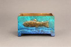 small bronze box with trout relief on two sides