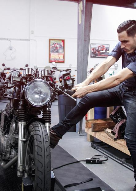 custom motorcycle man at work