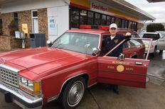 "Rev. Chris Carrara (a former ""Lawng Eyelander"") with his 1987 Ford Country Squire that originally served the Bloomfield (CT) FD as a chiefs car until recently when it was acquired by him for response duty as the Lewis County (NY) Fire Chaplain. Shown here with Bloomfield FD markings, the car will be appropriately marked with NYS Fire Chaplain logos by the time of the event."