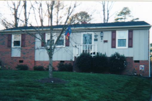 Exterior of home before siding replacement and new front porch addition