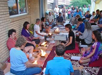 Community celebration with Agnihotra Vedic healing fire ceremony. Ellie Hadsall. Yagnya, agnihotra, homa, havan with multiple practitioners.