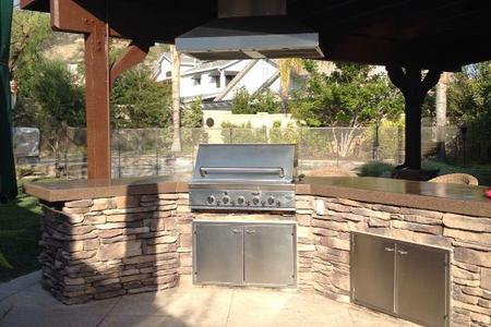 Outdoor Kitchen and Outdoor Entertainment by Top Construction