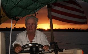 Rinker Buck at helm Flatboat Patience Photo By Dan Corjulo