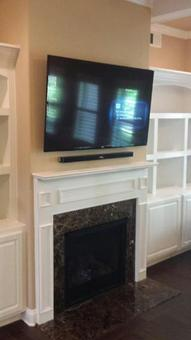 charlotte nc tv on fireplace mounting company, 4k ultra hd tv mounted on fireplace with floating sound bar