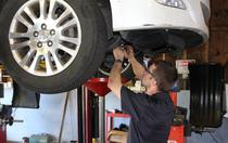 auto technician working on car repair