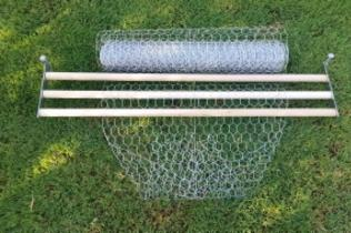 Tool to flatten chicken wire and hardware mesh fencing