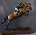 Bronze Thoroghbred jumping horse sculpture