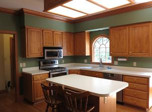 Kitchen before remodel had flourescent light above outdated island