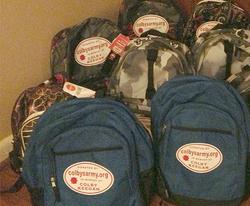 Colby's Army photo of backpacks filled with supplies for the homeless