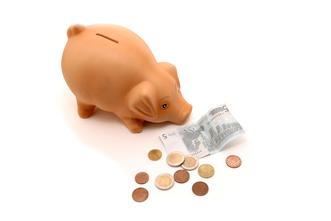 image of childrens piggy bank with coins FOR BUDGET TRAVEL PAGE