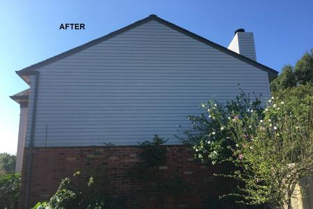 house wash cleaning siding in Houston TX after