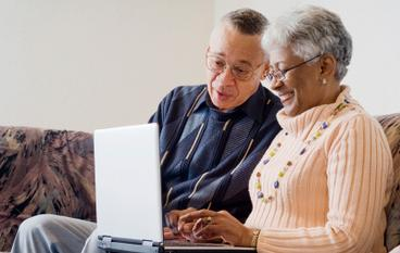 Elderly couple looking at the website
