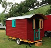 Island Girl's vardo, custom built by Jeanette & Chris, serves as accommodations while at multi-day events.