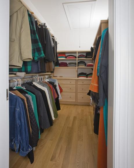Multi level closet off master bedroom in accessible home