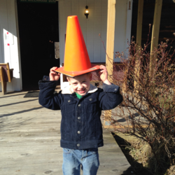 Colby's Army photo of a boy with a yellow traffic cone on his head