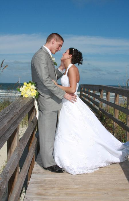 A bride and groom relax at their St. Augustine Wedding on the Beach