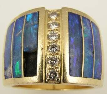 Opal ring in need of repair. Many broken pieces of opal.
