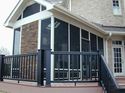 TimberTech flooring and railings accompany Real Stone and custom screening complete the look of this screened porch addition in North Raleigh.