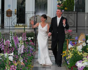 Newlyweds walk down the aisle on their wedding day at Como Conservatory in St. Paul Minnesota