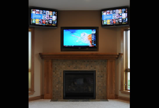 3 tv's mounted on wall