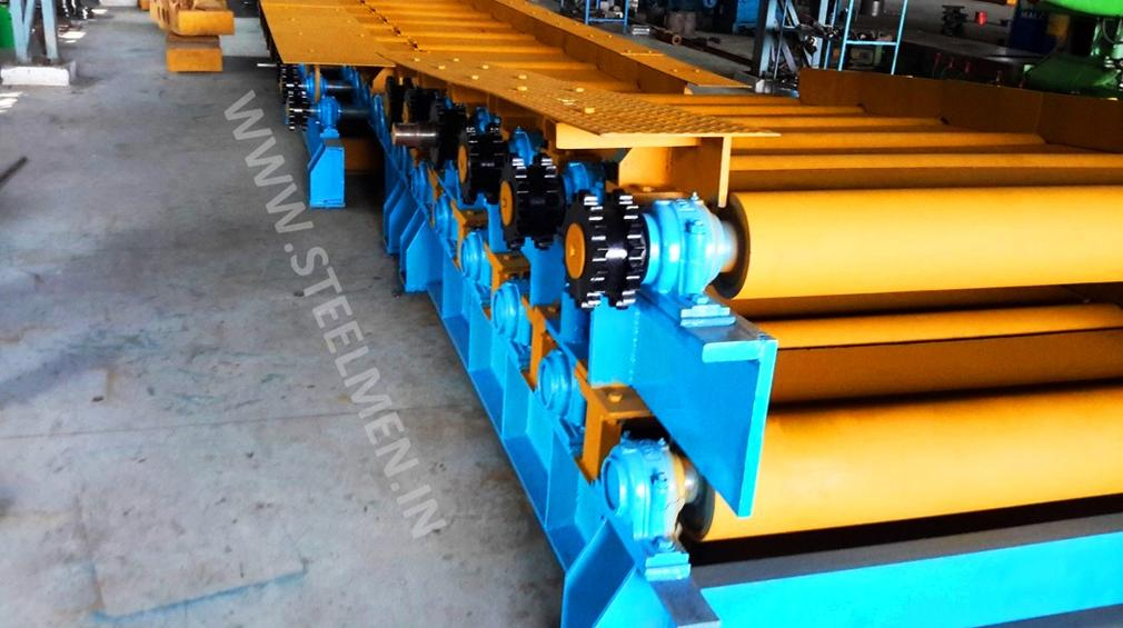Y-TABLE FOR ROLLING MILLS, OIL LUBRICATION SYSTEM (Capacity - 50 LPM to 300 LPM), AUTOMATIC BUNDLING MACHINE, Hot Billet Shear, Billet Charging Grate, Flywheel, Gear Boxes, Mill Stands, Shearing Machines, Conveyor Rolls, Spindle Carrier, Pinch Rolls, Tilting Tables, Twin Channel, TMT Quenching System, Tail Breaker Pinch Rolls, Oil Lubrication System, Guide Box & Twist Pipes Mechanical Pusher, Mill Accessories, TMT Chain Transfer System, Recuperators, Cooling Tower, gear coupling, universal spindles, steel rolling mill, rolling mill items, steel plant machineries, steel plants, CCM, Continuous casting machine, steel melting, steel makers, leju Thomas, 9310524787, Gear boxes, Pinion stands, Rolling mill Stands on Fiber& bearings, Roller tables, Tilting tables, Y tables, Guide boxes, Chocks, Couplings, Spindles, Rotary shears, Flying shears, Cantilever type pinch Rolls, Tail Breaker pinch Rolls, Quenching Systems (for 8-16 mm, 16-25 mm, & 25-32 mm), Twin channel, Hot Rolling Mills, Shears, Automatic Cooling Bed, Quenching Boxes, Twin Channel Machine, Mill Stands, Cold Rolling Mills, Gear Couplings, Industrial Gear Box, Punching Cropping Machine, Hot Saw, Transmission Tower Machinery, Chain Transfer Systems, Product Design Development, Hot Rolling Mills Bar Rolling Mill Hot Rolling Mill Equipment Slit Rolling Mill Shears Flying Shear Crank Shear Continuous Rotating Shear Disc & Drum Shear Automatic Cooling Bed Quenching Boxes TMT Quenching Boxes Twin Channel Machine Industrial Gear Box Helical Gear Box Rolling Mill Gear Boxes Mill Stands Rolling Mill Stands TMT Mill Stands Housingless Mill Stands Cold Rolling Mills Gear Couplings Gear Jobwork Punching Cropping Machine Hot Saw Traveling type Hot Saw Fixed type Hot Saw Transmission Tower Machinery Chain Transfer Systems Product Design Development, Turnkey Solutions For Hot Rolling Mills Coilers Mill stands Shears & hot saws Twin channel Cooling beds Gear boxes & pinion stands TMT Equipment, Rolling Mill Machines Blade Grinding Machine Hot Saw Machines Straightening Machine Hydraulic Pusher, Hydraulic Cylinders, Ejectors, Hot Rolling Mill Flywheels Gear Boxes Mill Stands Gear Couplings Material Handling Equipment TMT Equipment Cooling Bed Shearing Machines Straightening Machines Spare Parts Of Rolling Mills Other Allied Equipments Bending & Time Machine Workshop Machinery, ♦ Bar Mills ♦ Structural Steel Mill Wire Rod Mill with Bar in Coil Line Rolling Mill for High-Grade Steels Section Mill High Speed Laying Head with Gear Box Crank Lever Shears Crank Shears Housingless Stands Double Crank Shears Rake Type Cooling Conventional Mill Stands Gear Boxes Rod mill block Varioblock Flying Shear • Tail Braking Pinch Roll • Cold Shear, Starting Stock Billets 160 x 160 x 12,000 mm 130 x 130 x 12,000 mm Furnace Group Charging grate, Hot charging, Elevator, Induction online heater Finished product Rebar 8 three-strand slit TMT Rebar 10 two-strand slit TMT Rebar 12-40 mm TMT Flats, angles and channels are possible too Sub-bundles 100-400 kg Master bundles 1 MT-3 MT Furnace Capacity 80 MT/h Main train Single-strand H/V arrangement, two strands are H/V type Roughing train : 4 off Model 600, 2 off Model 440, Free outlet after stand # 2 Intermediate train : 4 off Model 440, 4 off Model 340 Finishing train : 6 x Model 340 Associated shears Loopers : 8 off vertical, 6 off Single strand, 2 off multi strand Capacity 400,000 MT/y Cooling bed group Water quenching line, Thermex Cooling bed shear Cooling bed 66 x 10 m Finished speed 16 m/s (20 m/s) Material grades Carbon steels, Alloyed Structural Steel grades Continuous finishing shop Stationary cold shear 3,000 kN Counting system Small bundle forming 4 off Tying machine Various associated equipment, e.g. stoppers, chain transfers, roller tables, Starting stock Blooms 180 x 180 x 8,000 - 12,000 mm 300 x 300 x 8,000 - 12,000 mm Finished product Rebars 28 - 40 mm Rounds 30 - 100 mm dia. Hexagons 50 - 80 mm Flats 8 x 30 - 60 x 150 H-Beams 100 - 180 mm I-Beams 100 - 200 mm T-sections 75 - 140 mm Channels 100 - 200 mm Angles 80 x 80 x - 200 x 200 mm U-type sections for mine timbering 18U, 25U,29U Bundle/stack length 6 - 24 m Bundle/stack weight 2 - 5 t Furnace capacity 116/143 t/h Annual capacity 700,000 t/y Finishing speeds 6 m/s Material grades Carbon steels, Alloyed structural steel,Antifriction bearing steel Furnace group: Elevator (for hot charging), charging grate,weighscale, descaler, insulated holding tunnel Mill train: Single strand Roughing train 4 x Model 670, 1 x Model 760(V-H-HV-H) Intermediate train: 2 x Model 760, 4 x Model 670(H-H-H-UR-UR-HV) Finishing train: 5 x Model 670 (UR-HV-UR-HV-FUR) Associated shears Loopers: 4 x vertical Cooling bed group: Water cooling line, pinch roll unit Cooling bed shear Cooling bed 84 x 19 m Short-bar collecting device Continuous finishing shop In-line straightening machine (10 rollers) Hot saws: 1 x stationary, 1 x movable Abrasive cutting machines: 1 x fixed, 1 x movable Piling and stacking facilities (magnet-type) Tying machines: 2 x stationary, 2 x movable Various associated equipment, e.g. stoppers, chain transfers, roller tables. upto 150 x 150 x 12,000 mm Finished product: Wire rod 5.5 - 16 mm Rebars Nos. 3, 4 and 5 (as per ASTM) Coils 16 - 42 mm dia. Furnace capacity: 70 t/h Annual capacity: 300,000 t/y Finishing speeds: Wire rod line - 100 (120) m/s Bar in coil line - 13.5 m/s Material grades: Cold-heading steels Reinforcing steels Steels with a carbon content from low to medium Piano-wire PC-wire Free-cutting steel Water cooling line, pinch roll units, bar reels (2x), coil transfer,chain conveyor with retarded and accelerated cooling facilities, transfer unit to Power & Free coil handling system, Starting stock Billets 50 x 100 x 10,000 mm 125 x 125 x 11,400 mm Finished product Rod 5.5 - 13.5 mm dia. Bars 11 - 57 mm dia. Flads 22 - 120 mm, 5 - 12 mm thick Bundle/stack length 3 - 8.5 m Bundle/stack weight 0.5 - 3 (5) t Furnace capacity up to 60 t/h Material grades High-grade structural steels 34 Cr 4, 60 SiMn7, 42 CrMo4 Antifriction bearing steels 100 Cr 6, 100 Cr 2, 100 CrMo 7 3 Material grades Tool steels X 210 Cr 12, X 38 CrMoV 5 1, 55 CrNiMoVS 4 2 4 Acid-resistant and heat-resistant steels X 5 CrNiMo 18 11, X 2 CrNiMo 19 13,X 20 CrNiSi 25 4 High-speed steels X 79 Wco 18 5, X 82 W Mo 6 5 5 Special alloys X 55 CrMnNiN 20 8,X 45 CrSi 9 3 X 3 CrNiMoNbN 23 17 The complete range of steel grades includes approx. 300 different grades Furnace group: Charging grate, cross transfers, weighscale, descaler (2x), heatholding tunnel Mill train: Single strand, H/V - arrangement Roughing train: PSW and 6 x Model 440 Intermediate train: 4 x Model 440, 2 x Model 340 Finishing train: 4 x Model 340 Kocks-block 8-stand wire rod block for high grade steels 3 x 215/ 5 x 170 Associated shears Loopers: 7 x vertical, 1 x horizontal Cooling bed group: Water cooling line, pinch roll unit Cooling bed shear Cooling bed 57 x 5 m Continuous finishing shop: Abrasive cutting machine Piling and stacking facilities (non-magnet type) Tying machines: 1 x fi xed, 1 x movable various associated equipment, e.g. stoppers, chain transfers, roller tables etc. Rod finishing equipment: Water cooling and equalizing sections, pinch roll unit,laying head Ring conveyor for retarded and accelerated cooling reforming tub Pallet-type coil handling system, compacting & tying units,weighscale, unloading station Reel plant Water cooling and equalizing sections, Pinch roll units, Bar reels: 2 x, Transfer equipment to pallet-type coil handling system, Omsairam Steel & Alloys Pvt. Ltd., Bhagyalaxml Rolling Mills Pvt. Ltd., Kalika Re-rollers Pvt. Ltd., Parvati Alloys (P) Ltd., MITC Rolling Mills (P) Ltd., Maharashtra Steel Rolling & Engg Co. Chimanlal Vijay Kumar Steels Pvt. Ltd, Bhagwati Ferro Metals (P) Ltd, Balbir Rolling Mills Ltd. Quartz Metals Inds., Metro Alloys Ltd., Pushpak Steel Inds. Pvt Ltd., T. k. Ispat Pvt Ltd., Allied Ferromelt Pvt Ltd., Bhagwati Steel Cast Ltd., R. L. Steels Ltd., Guardian Steels Pvt. Ltd., Shri Karvir Nivasini Mahalakshmi Ispat Pvt. Ltd., Khatu Shyamji Steel Rolling Mills Pvt. Ltd., Kunal Ispat & Alloy Inds. Pvt Ltd. Sun Metallics & Alloys Pvt. Ltd, Hans Ispat Ltd. Shri Khatu Shyam Industries, Rajuri Steel Pvt. Ltd, Shree Om Steel Rolling, Air Carrying Corpn (I) Ltd., titan Alloys Ltd. Sunflag Iron & Steel Co. Ltd., Sharda Ispat Ltd., Fortune Metaliks Ltd., Sharda Shree Ispat Ltd., R. K. Structures Pvt. Ltd., Sanvijay Industries Pvt. Ltd., Shivali Udyog (I) Ltd., S.D. Bansal Iron & Steel Pvt. Ltd., Inertia Iron & Steel Inds. Pvt. Ltd., Nalwa Steel & Power Ltd., Shilpa Re-rollers Ltd., Sri Jai Balaj Steel Rolling Mills Ltd., Petropol India Ltd. Galwalia Ispat Udyog Pvt. Ltd. Crest Steel & Power Pvt. Ltd. Himalayan Rolling Steel Industries Pvt. Ltd., Shree Balaji Pigments Pvt. Ltd., Upper India Steel Mfg. & Engg. Co. Ltd., Capital Ispat Ltd., Barnala Steels Inds. Ltd., Shri S.S. Shyam Steels Pvt. Ltd. Fortune Metals Ltd. Rathi Udyog Ltd., M/s. Gallantt Ispat Lyd., Gemini Merchandise Pvt. Ltd., Jagdamba Rolling Mills, Shree Krishna Steel Rolling (Jaipur) Ltd. Modi Steels, Usha Martin Inds. Prince TMT Steels Pvt. Ltd., Dindigul Iron & Steel Co (P) Ltd. ARS Metals Ltd. V.V. Iron & Steel Company Pvt Ltd. Jairaj Ispat Ltd., Pioneer Torsteel Mills (P) Ltd., Devshree Ispat Pvt. Ltd., Vaibhav Merchantile Ltd., Maa Mahamaya Inds. Pvt. Ltd., Chitrakoot Metal Ltd. P. R. Rolling Mills Pvt. Ltd. Shree Aravindh Steels Ltd. Shyam Steel Industries Ltd. Shri Ramrupai Balaji Steels Ltd. Adhunik Ispat Pvt. Ltd. Durgapur Steels Ltd. B. M. A. Stainless Ltd. Zion Steel Ltd. Shree Metaliks Ltd. Usha Martin Ltd. Shyam Sel Ltd. Maithan Steel & Power Ltd.