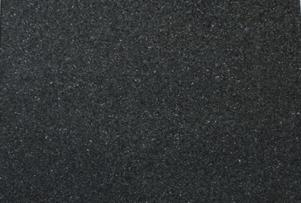 Uba Tuba Granite a dark color with hints of brown, black, gold, and sometimes blue, green, and silver