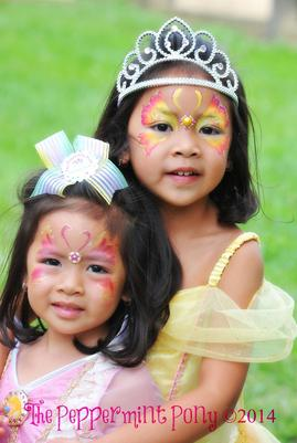 beautiful sister princesses with face painted butterflies