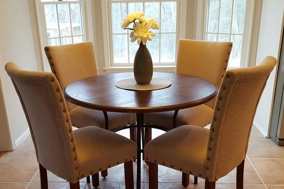 My favorite staging piece is the upholstered dining chair. Even when they aren't expensive, the upholstered chair bring a elevation of lifestyle to any dining area.
