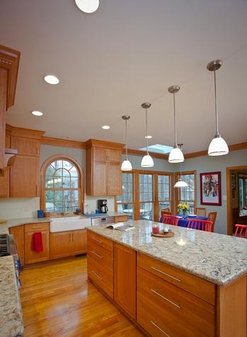 Natural cherry cabinets topped with quartz countertops