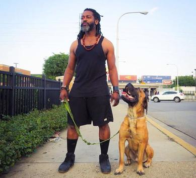 Toriano Sanzone walking a dog