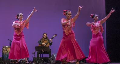 Flamenco guitarist Leah Kruszewski teaches flamenco to visitors in Seville, Spain