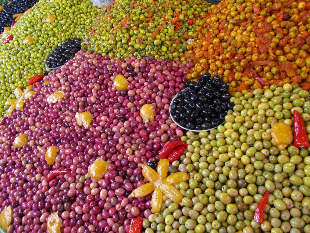 a table in a market covered with thousands of olives