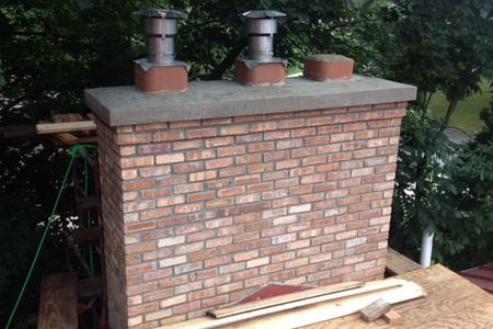 Ann Arbor home chimney rebuild. Bricks were torn down and relaid. The flue and flue liner were replaced.