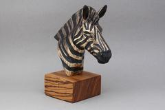 Zebra bust with a base made of zebrawood