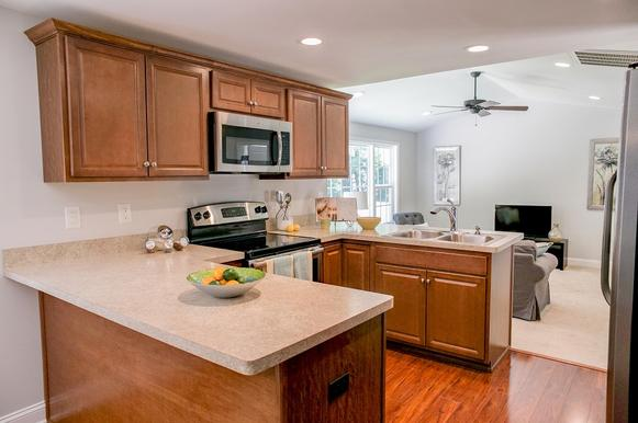 Vacant home staging includes light accents and accessories in the kitchen area as well as more empty spaces of the home.
