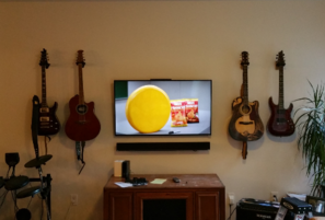 TV Wall mount installation and sound bar mounted below, carolina custom mounts