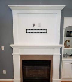Custom Fireplace Niche Cover up with tv mounted, Carolina Custom Mounts