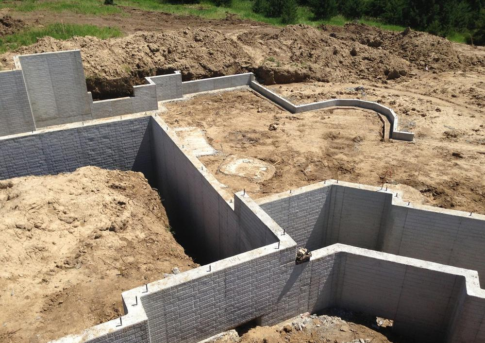 Lee coe contractors inc poured concrete foundations for Poured wall foundation