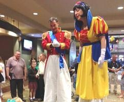 Costumed Stilt Walkers at a Corporate Event. Entertainment for Themed Events.