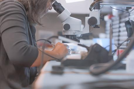 microscope woman design engineering development