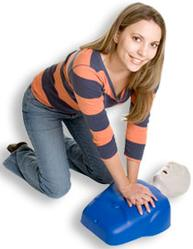 Image of young female practicing CPR on blue training mannequin
