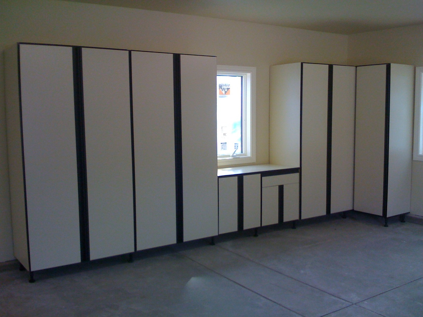 slide premiere minnesota cabinets closet in organizers and walk garage s system custom