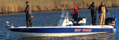 four men fishing on ugly fishing vessel tensaw river