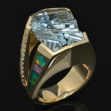 Australian opal ring with Munsteiner fantasy cut aquamarine accented with pave` set diamonds in 14k gold by Hileman.