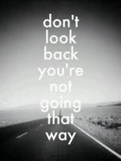 "Black and white photo of a open road with caption ""Don't look back you're not going that way"""